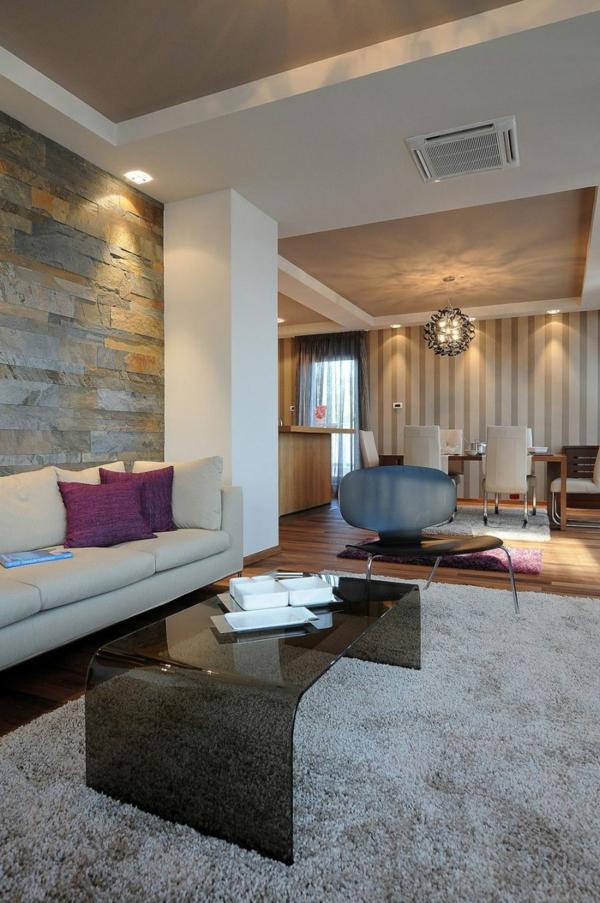 exklusive penthousewohnung ovaler couchtisch aus dunklem glas