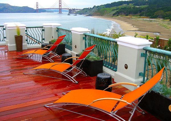innendesign ideen orange farbe terrasse veranda liege liegestuhl