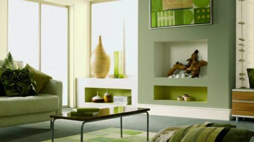 kamin dekoration olivengrün und treibholz