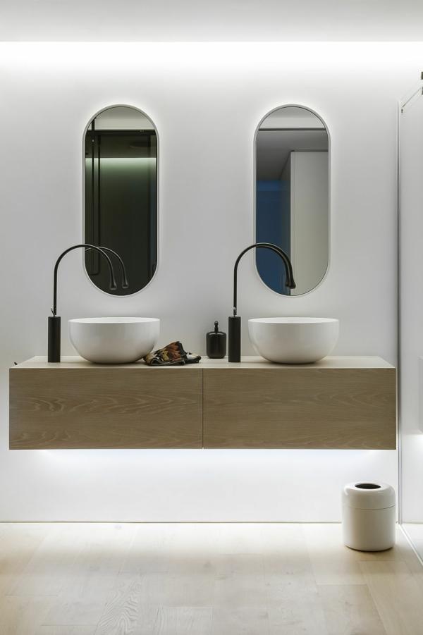 luxus badezimmer schalenförmige waschbecken und ovale wandspiegel