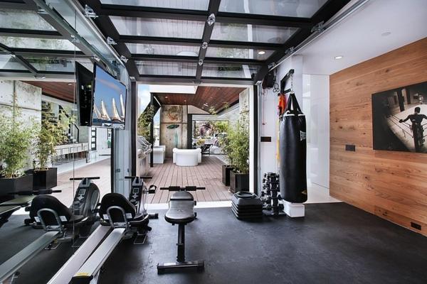 moderne luxusvilla fitnessbereich
