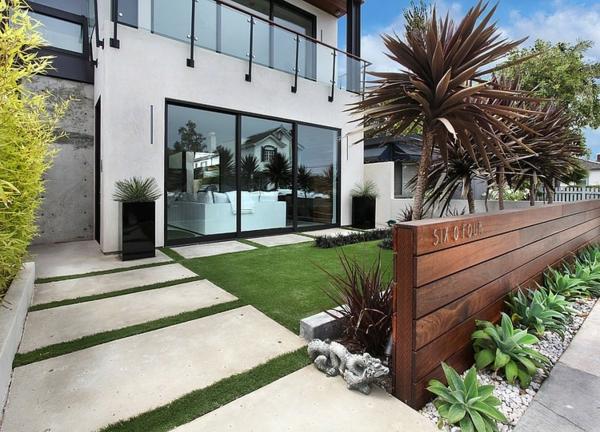 moderne luxusvilla steinpaltten und grüne wiese