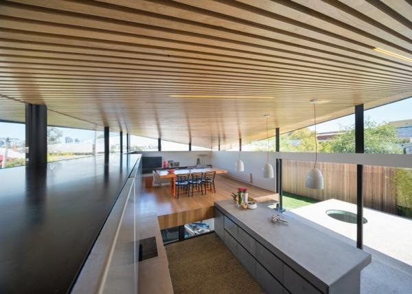 Unkonventioneller Hausanbau architektur küche insel hängelampen