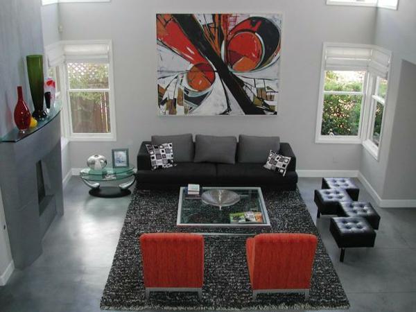 betonfußboden in grau glänzend mit teppich drauf