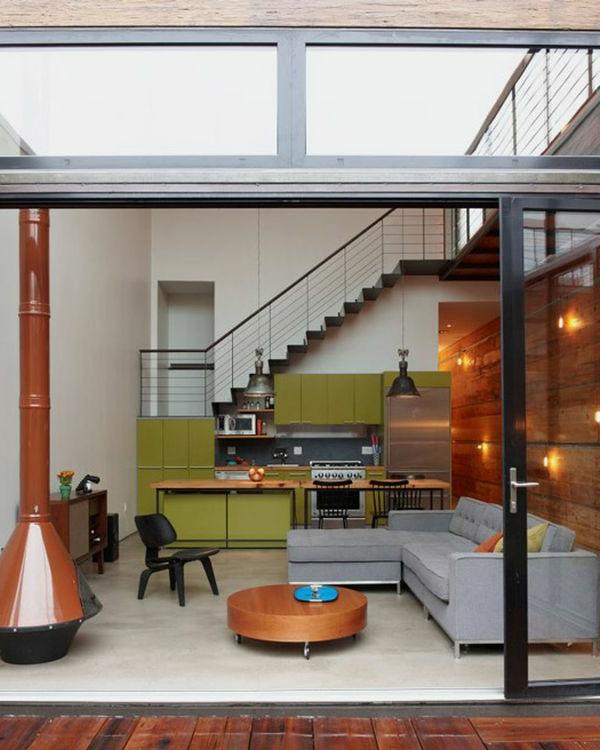 wohnzimmer grün schranktüren tisch niedrig rund