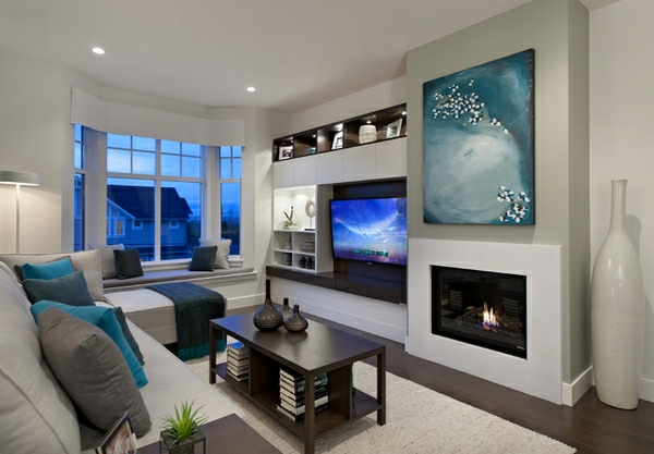 wohnzimmermöbel moderner kamin und abstrakte wandkunst