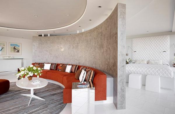 Raumteiler und Trennwand mark englisch architects orange sofa