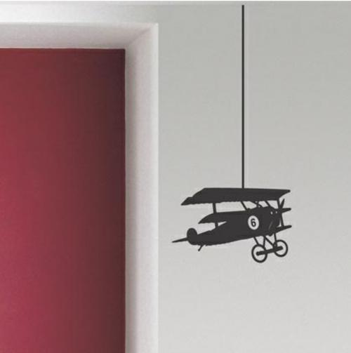 Wanddekoration mit Wandtattoo flugzeug hängend rot