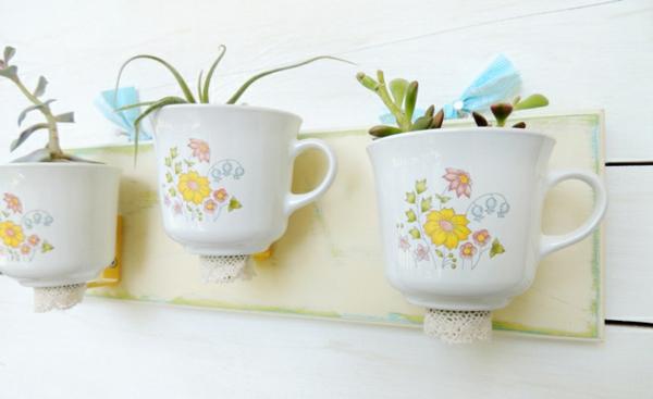 tee tassen süße übertöpfe an der wand