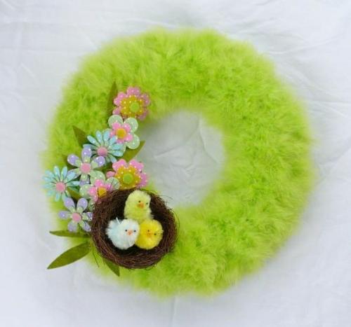 osterkranz selber machen neongrüne feder filzblumen deko nest