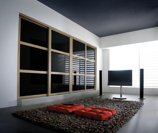 übergroß warderobe schwarz glanzvoll oberflächen schiebetüren weich teppich
