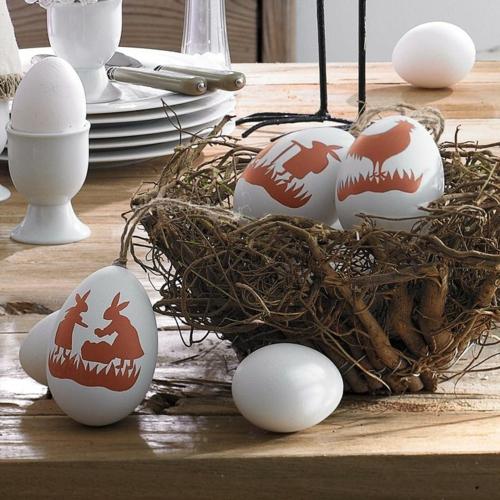 Dekoideen für Osterdeko mit Ostereiern nest zweige