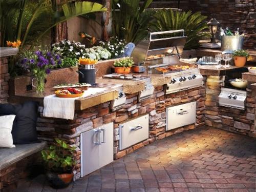 schön außenKüche mit Grill feuerstelle stein bodenbelag