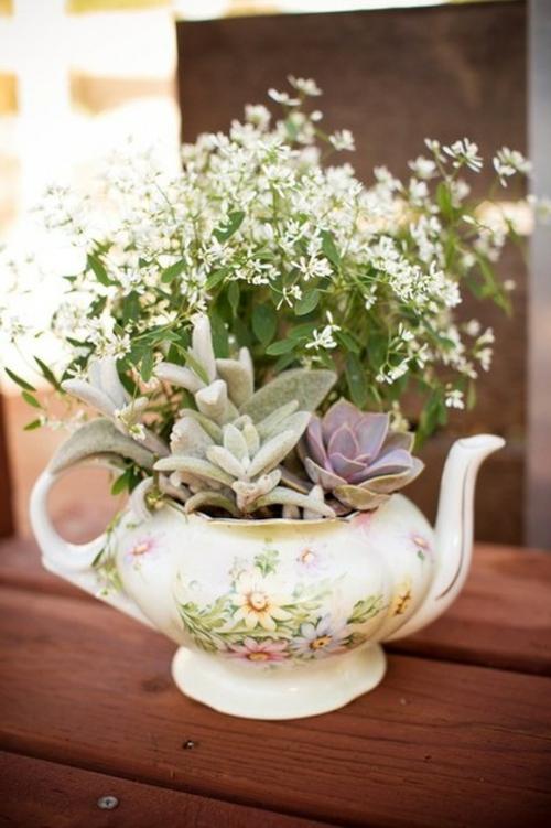 erfolgreiche Gartengestaltung blumenarten fliesen teekanne blumenvase
