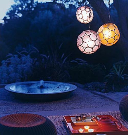 gartenbeleuchtung tipps ideen pendelleuchte sitzkissen