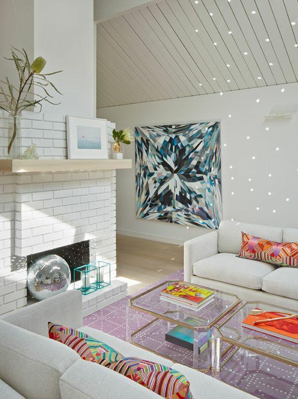 möbel aus acrylglas couchtisch durchsichtig elegant dekokissen bunt