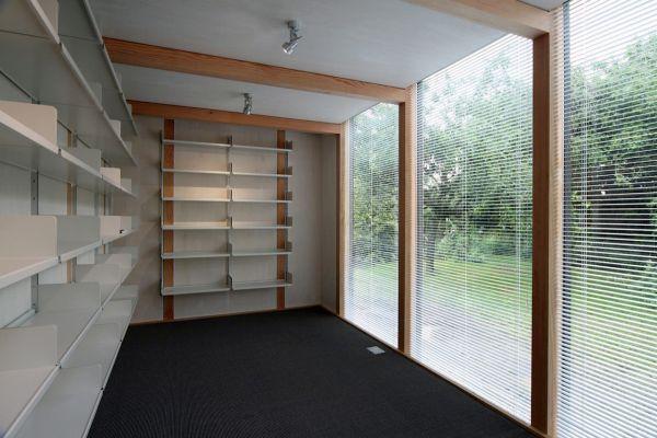modulares kubus gartenhaus fertighaus bibliothek holz bücherregale