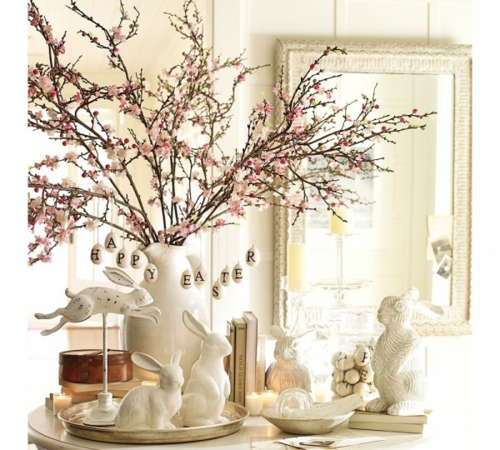 osterdekoration pfirsigzweige weiße hasen porzellan