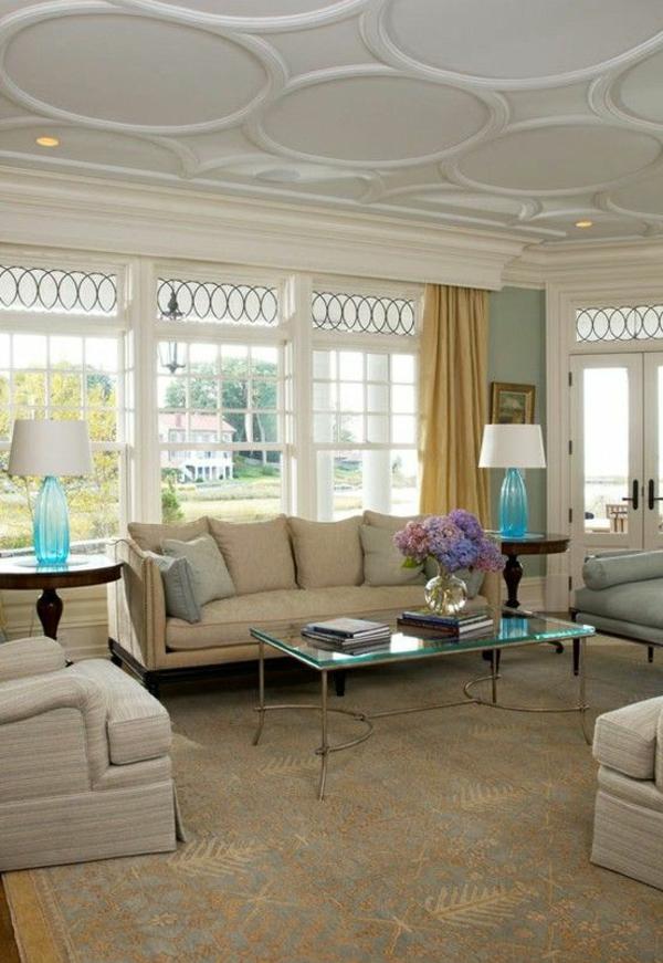 deckengestaltung kreisförmig tisch sofa teppich
