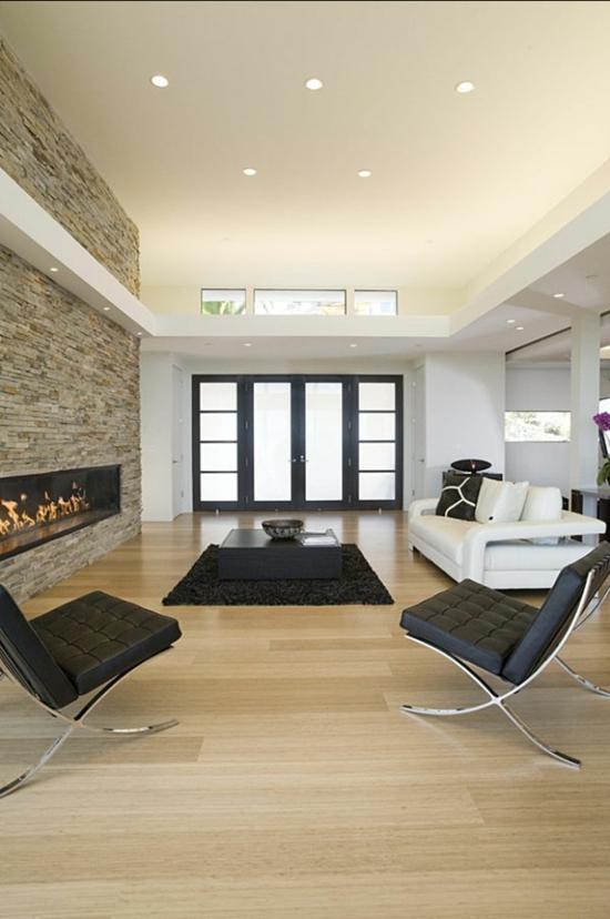 deko kamin im wohnbereich wohnzimmer einrichten sessel minimalistisch einbauleuchten