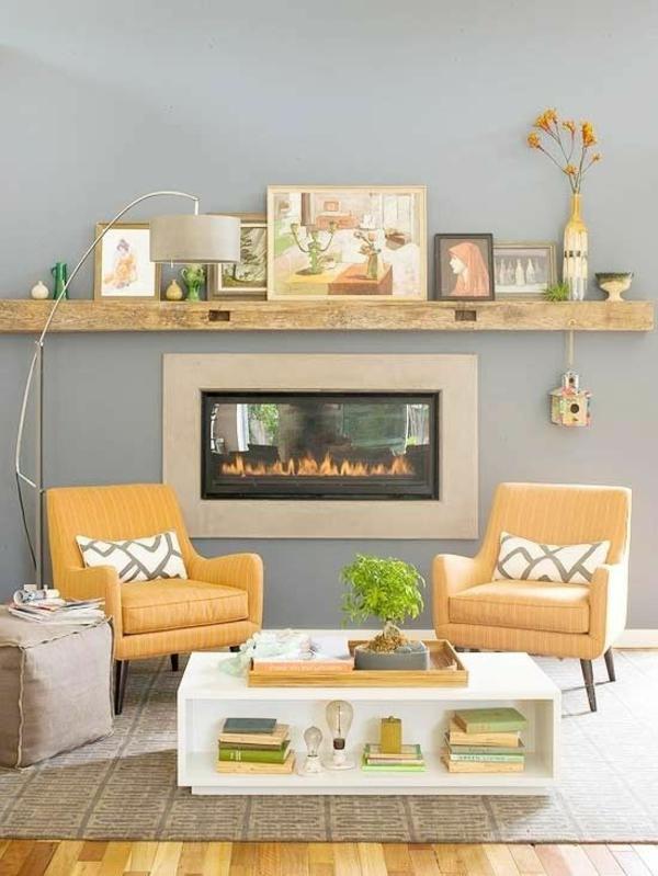 einrichtungsideen wohnzimmer eingebauter kamin tisch lagerraum gelbe stühle