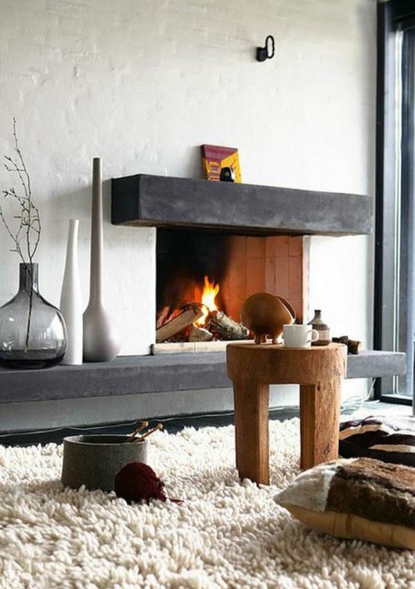 energiesparen wohnideen kamin teppich stuhl kissen