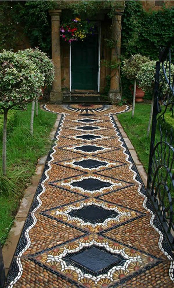 gartendesign steine mosaik eisen zaun tür haus