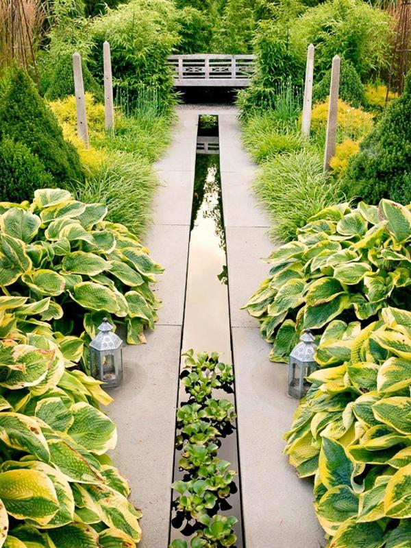 gartendesign wassermerkmal grüne pflanzen laternen