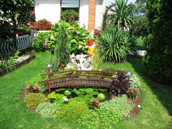 gartengestaltung ideen gartenbau teich anlegen kleine brücke wasserlilien