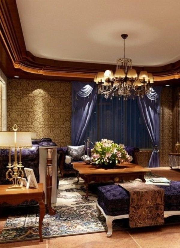 luxus wohnzimmer lila akzente kronleuchter tisch