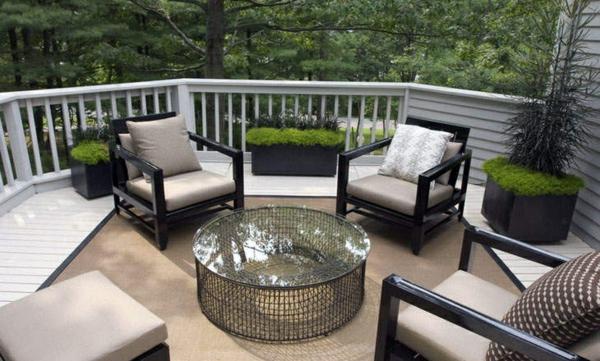 moderne terrassengestaltung tisch designideen dekokissen pflanzen sessel