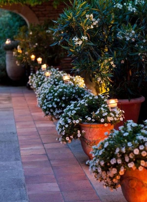 pflanzenrhytmus übertöpfe steinpflaster beleuchtung