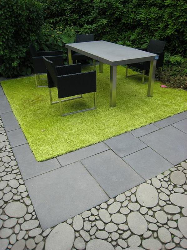 gartengestaltung ideen bilder steinpflaster und kies grüne teppich tisch