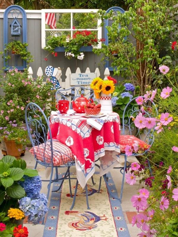 teezeit im garten gartenmöbel schmiedeeisen bunte decke stein bodenbelag