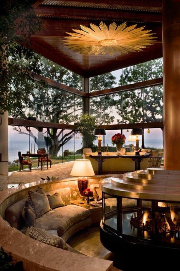 terrassengestaltung modern runde sitzecke kamin lampen dekokissen dekoideen