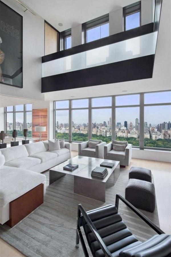 traumhaftes wohnzimmer  in grau sofa sessel tisch hocker