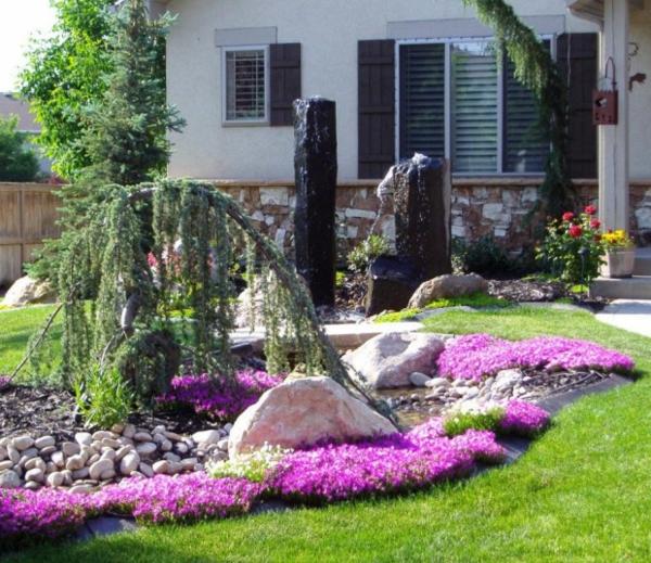 blumenbeet gartenteich flusssteine vorgarten gestalten gras bunt