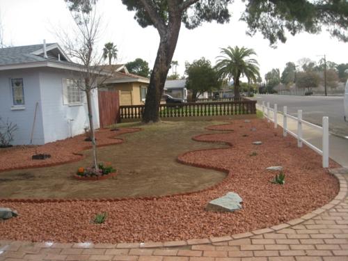 vorgartengestaltung mit kies gewülbte formen natursteine