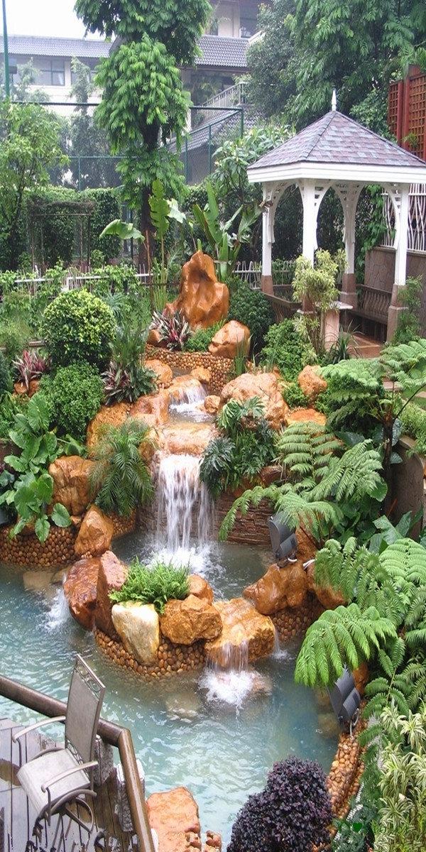 wasserfall im garten steinendeko pflanzen