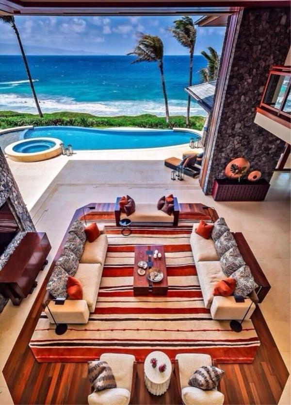wohnideen zimmer mit meerblick sofas tisch teppich