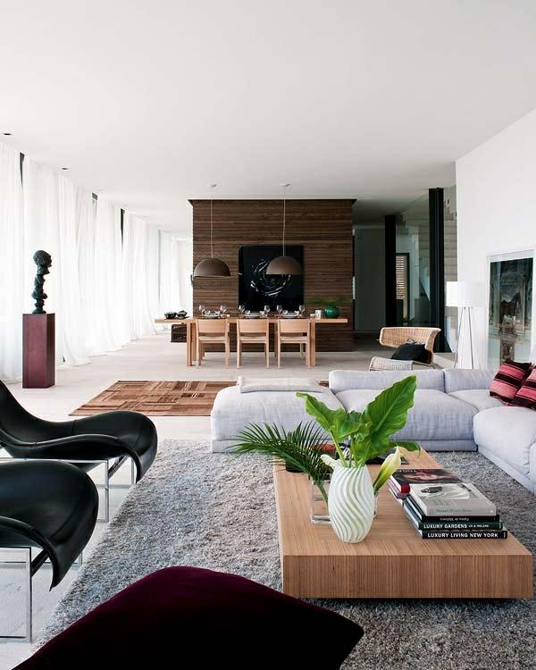 wohnzimmer einrichten offener raum stühle sofa teppich tisch