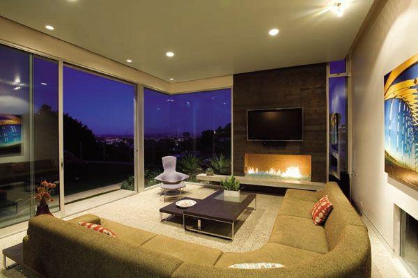 wohnzimmer ideen mit prächtiger aussicht rundes sofa tv