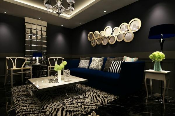 wohnzimmer luxuriös gestalten schwarze wände wanddeko
