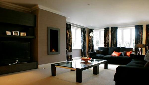 wohnzimmer luxuriös gestalten schwarzes sofa gardinen tisch