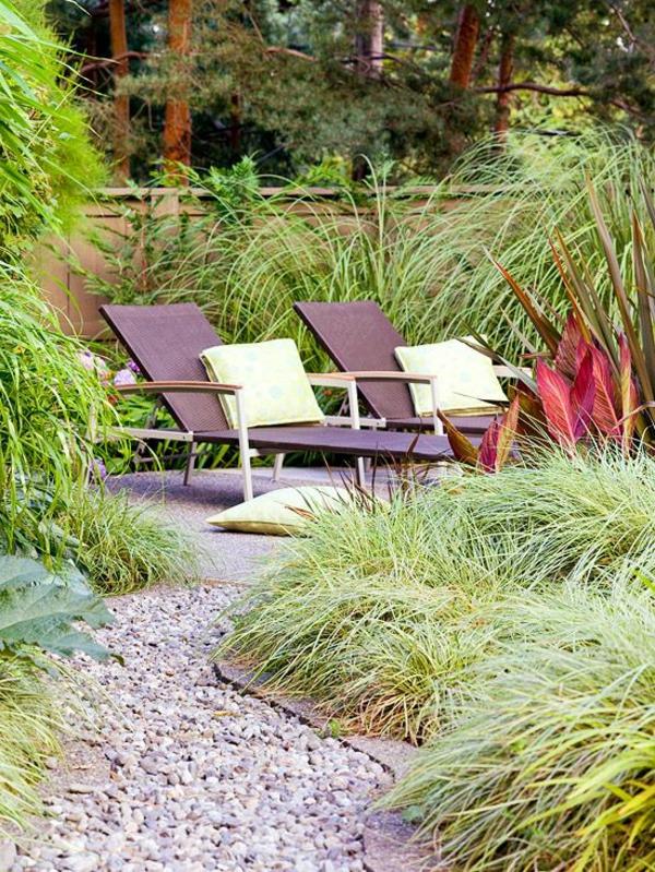 Gartengestaltung Kies Steinen rattan liegen kissen