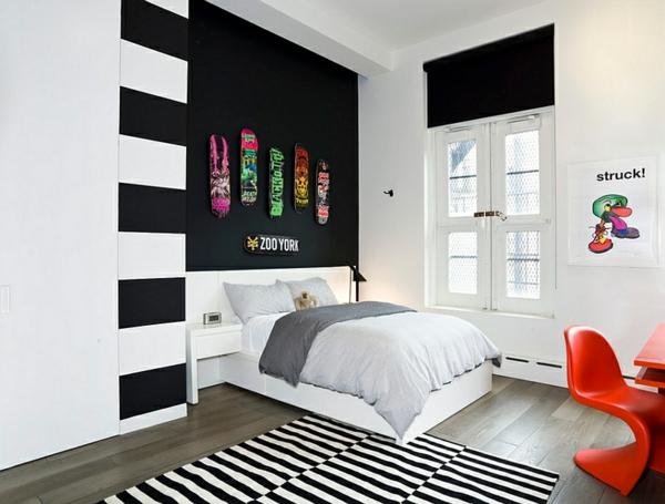 Teen schlafzimmer in schwarz-weiß stuhl orange
