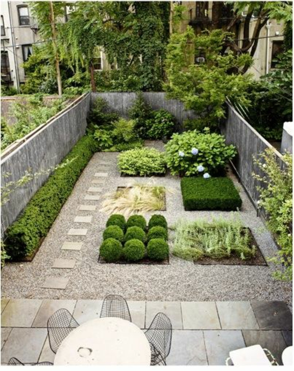 gartengestaltung mit steinen betonmauer pflanzen