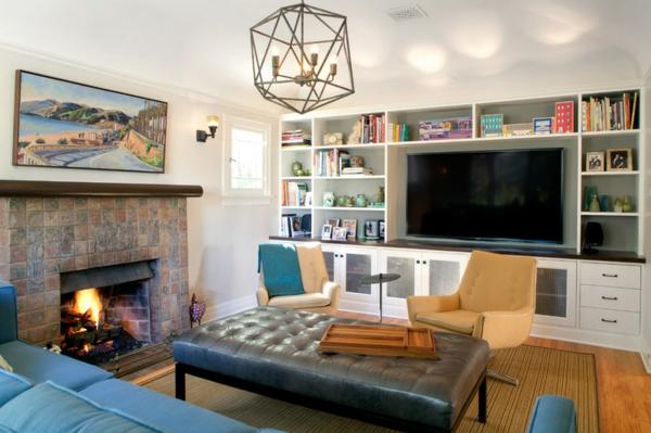 kamin im wohnzimmer gestalten möbel sofa bücherregal ottomane