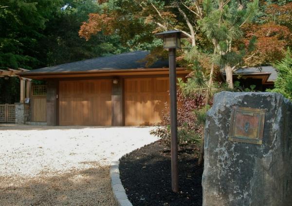 landhaus vila vorgarten mit kies briefkasten eingebaut naturstein