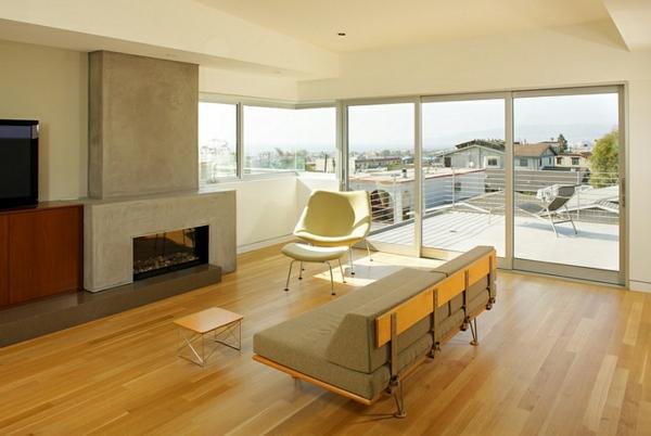 minimalistisch wohnzimmer bodenbelag holz feurstelle eingebaut sofa